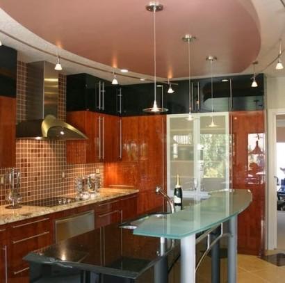 Diseño de pequeña  cocina moderna con isla de vidrio
