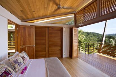 Dormitorio de casa clima tropical