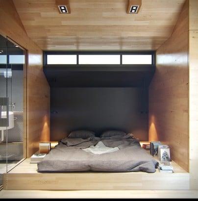 Dormitorio de pequeño apartamento con ventana alta