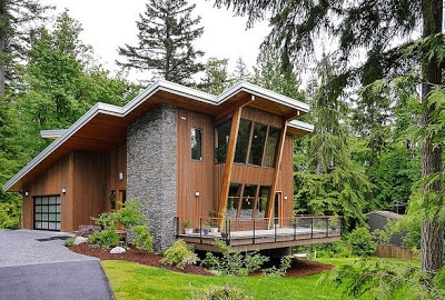 Dise o de interiores r stico de casa rural madera y for Fachadas hoteles minimalistas