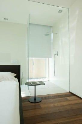 Diseño de ducha en dormitorio