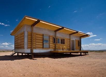Pespectica de casa construida con varios materiales