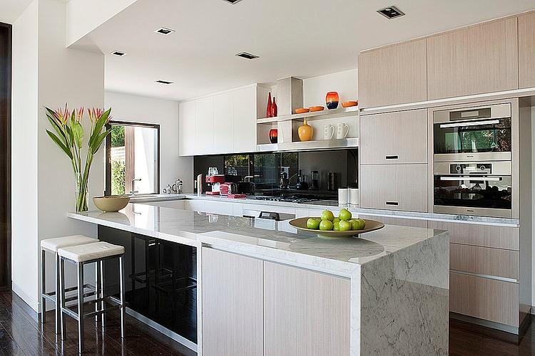 Dise o de casa moderna en esquina fachada e interiores for Islas de cocina con desayunador