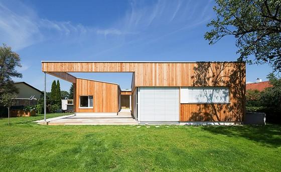 Fachada de casa de una planta de madera de un piso