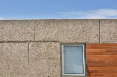 Detalles de piedra fachada hormigón y madera