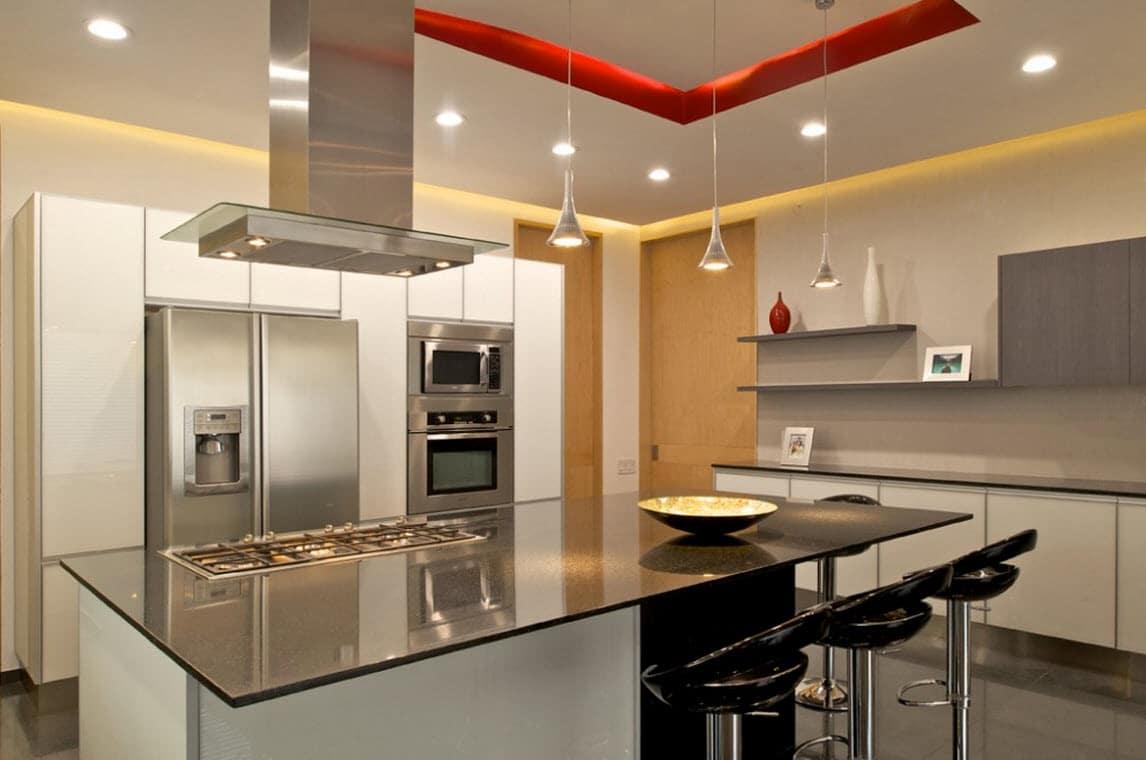 Dise o de planos de casa de dos plantas construye hogar for Islas de cocinas modernas con desayunador