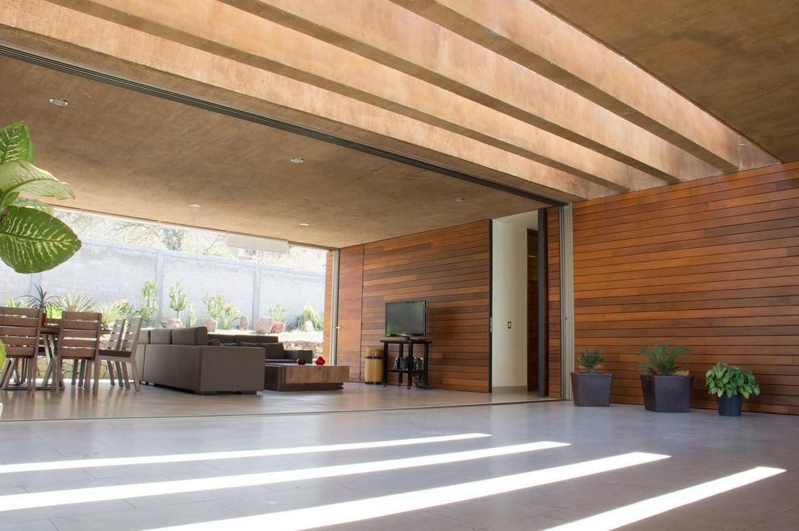 Dise o de casa cuadrada con planos y fachadas construye for Salas de madera modernas
