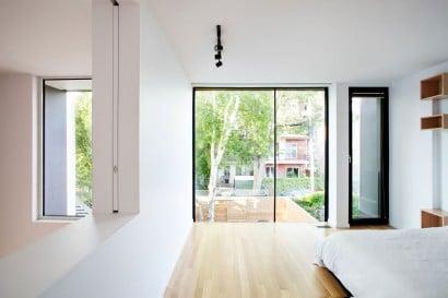 Diseño de dormitorio vista hacia la calle