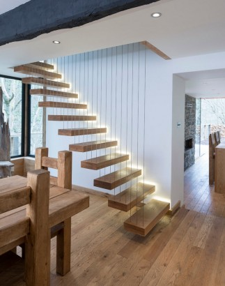 Diseño de escaleras modernas con tirantes de acer