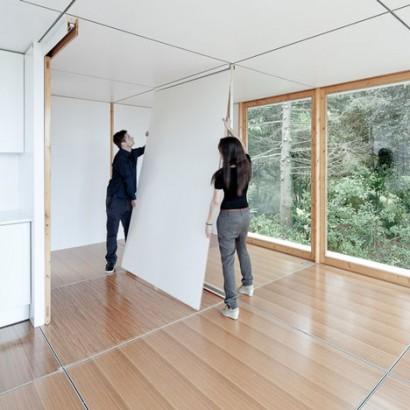 Colocación de paneles en interiores de pequeña casa