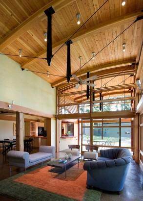 Diseño de techo con tirantes de acero de casa de madera