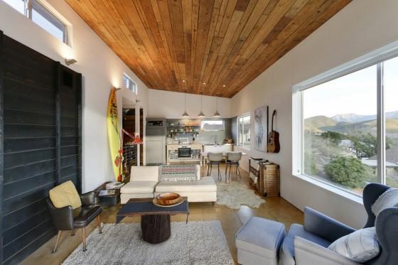 Diseño de sala y cocina de cabaña moderna