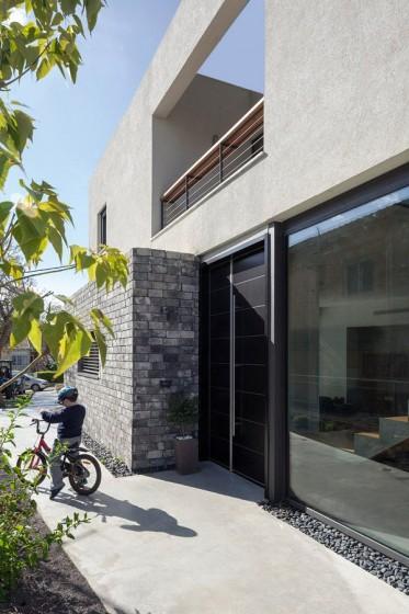 Detalles constructivos de fachada con aplicaciones de piedra