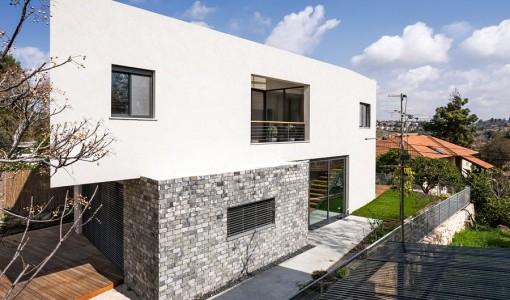 Diseño de fachada moderna de dos pisos