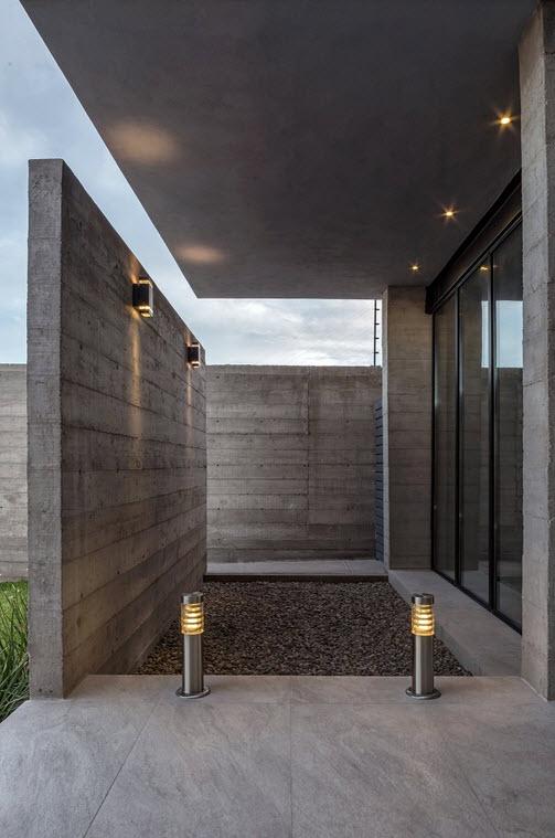 Muro de concreto en fachada de casa construye hogar - Casas de cemento ...