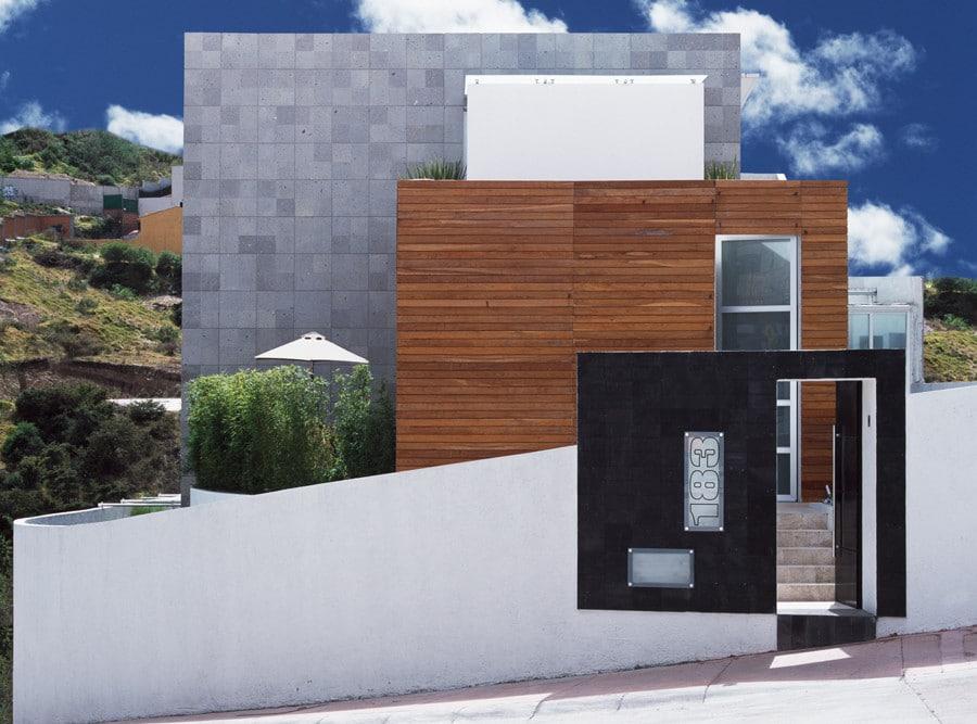 Casa moderna dos pisos tres dormitorios construye hogar for Acabados fachadas minimalistas