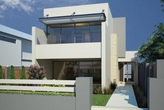 Pequeña casa de dos pisos con hormigón y piedra