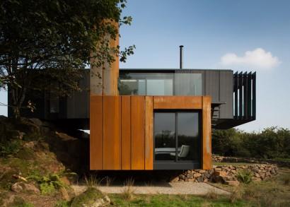 Perfil de casa reciclada de dos pisos