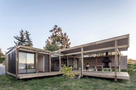 Fachada posterior madera casa campo