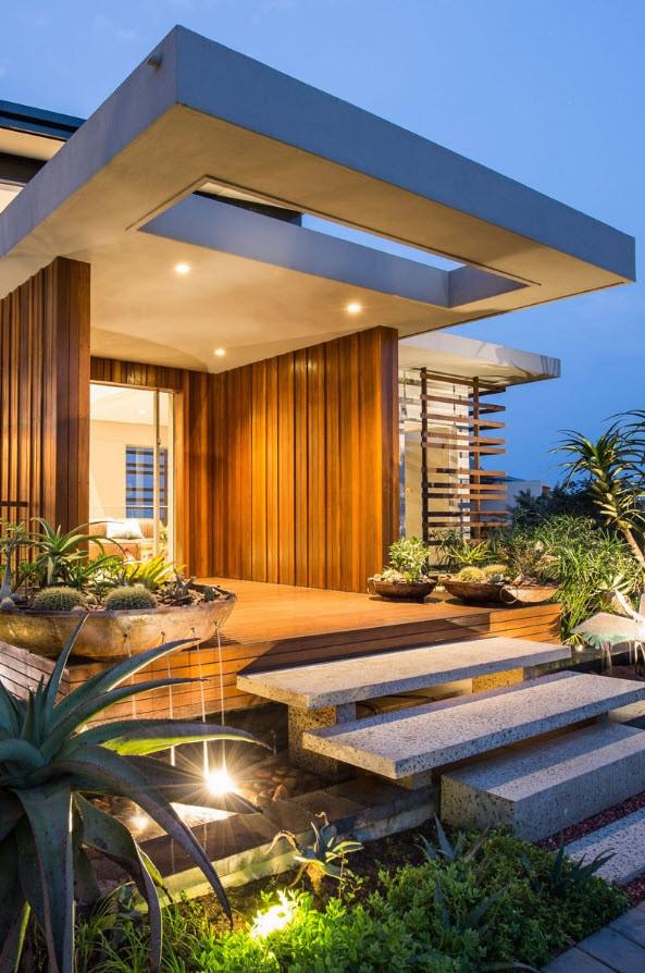 Dise o de fachada de casa moderna con fotos construye hogar for Portico moderno