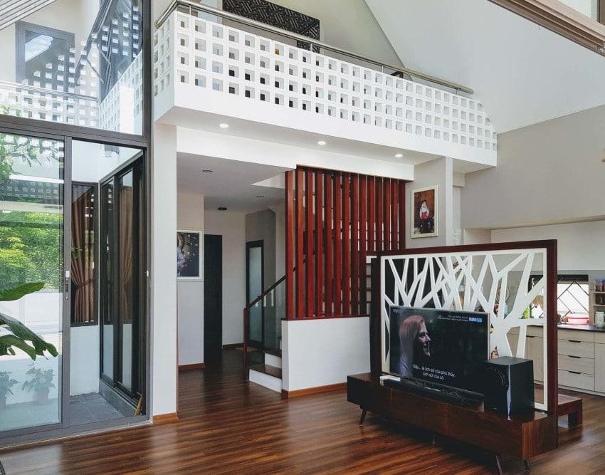 Dise o de peque a casa de dos pisos moderna armoniosa for Diseno casas pequenas modernas