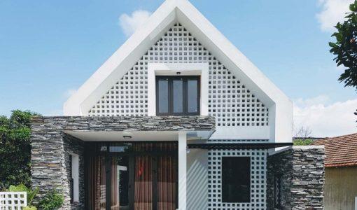 diseo de pequea casa de dos pisos moderna armoniosa estructura con piedra y muros calados