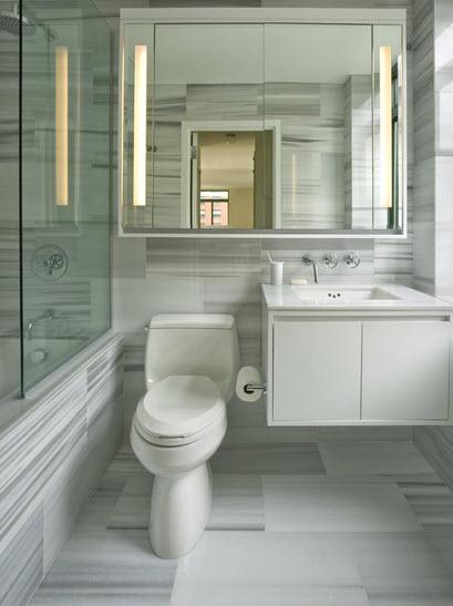 Rayas blancas y grises en este diseño de baño