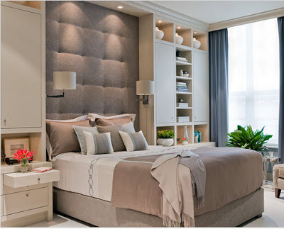 Diseño de habitación matrimonial con gabinetes en respaldo
