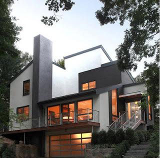 Diseño de casa moderna en color blanco dentro del bosque