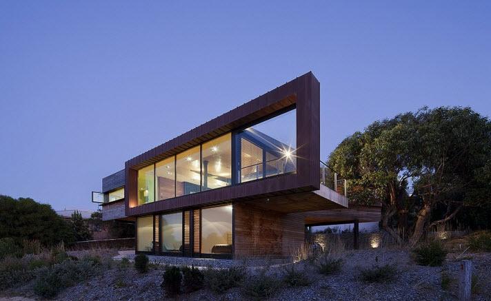 Dise o de casa de dos pisos moderna ubicada en pendiente for Fachadas de casas modernas a desnivel
