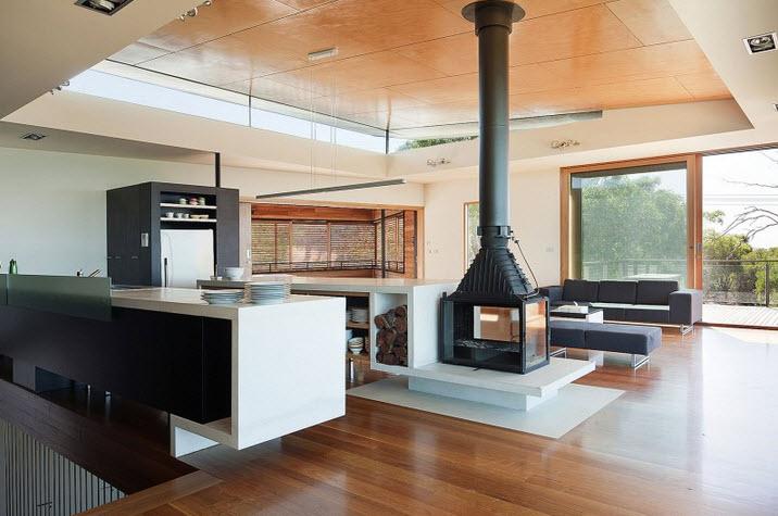 Dise o de casa de dos pisos moderna ubicada en pendiente for Casas modernas de un piso por dentro