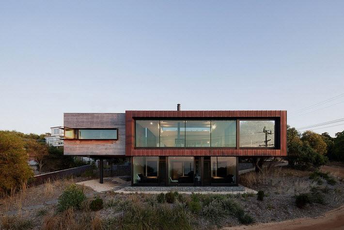 Dise o de casa de dos pisos moderna ubicada en pendiente - Casas en pendiente ...