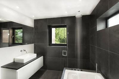 Diseño de cuarto de baño moderna con azulejos blancos y grises