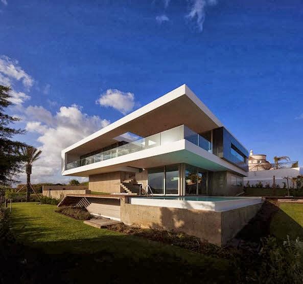Fachada y planos de una casa moderna frente al mar for Como hacer una fachada de casa moderna