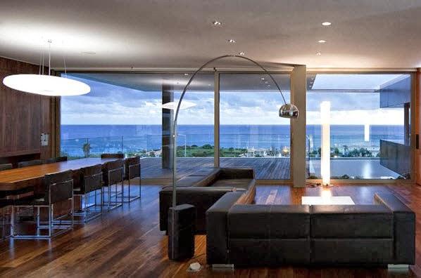 Fachada y planos de una casa moderna frente al mar for Casa moderna frente al mar