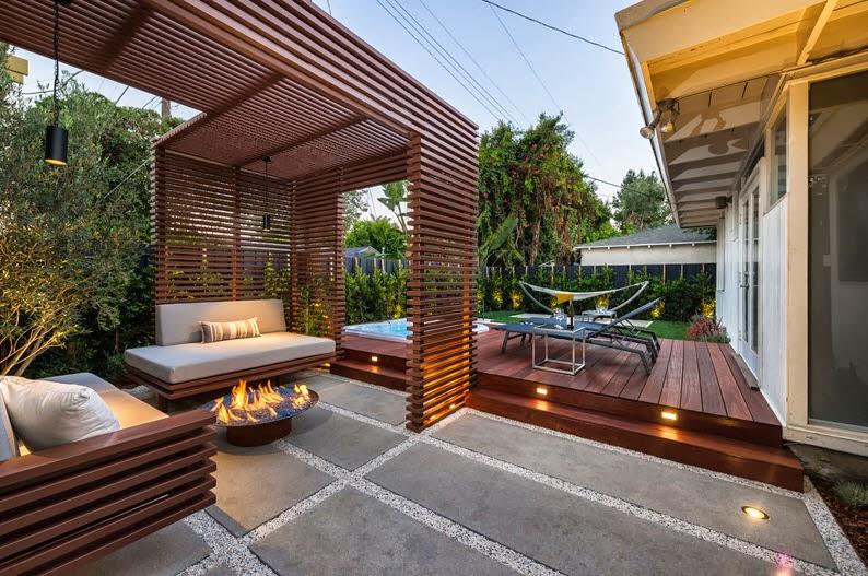 Dise o de una moderna terraza de madera de una casa en la for Iluminacion terraza