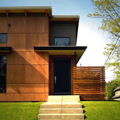 Fachada de casa moderna de campo enchapada de cubos de madera