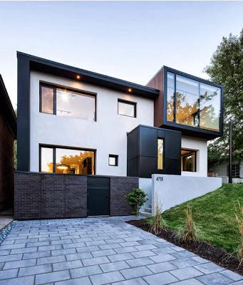 Fachada de casa moderna que ha sido  remodelada y ampliada
