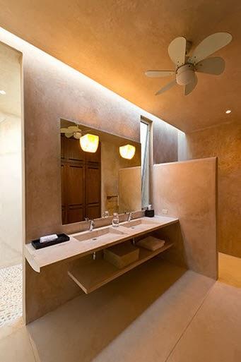Dise o de moderna casa hacienda con paredes hormig n for Disenos de banos modernos para casas