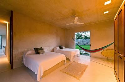 Dormitorio secundario de la casa hacienda dos camas