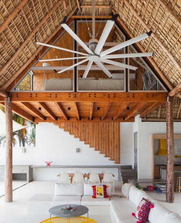 Dise o de moderna casa de playa hecha de madera bamb y for Bungalows dentro del mar