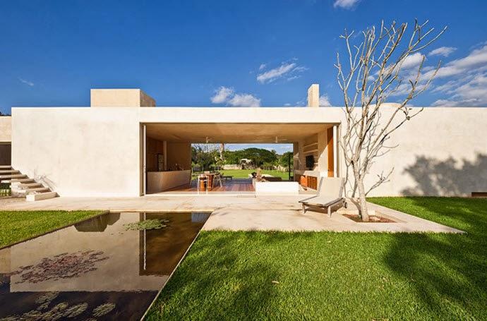 Dise o de moderna casa hacienda con paredes hormig n for Decoracion de casas tipo hacienda