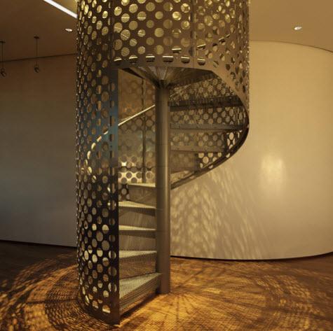 Diseño de escalera en espiral de metal perforado
