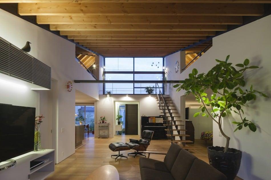 Dise o de casa moderna de un piso con techo en pendiente for Diseno de interiores 1960