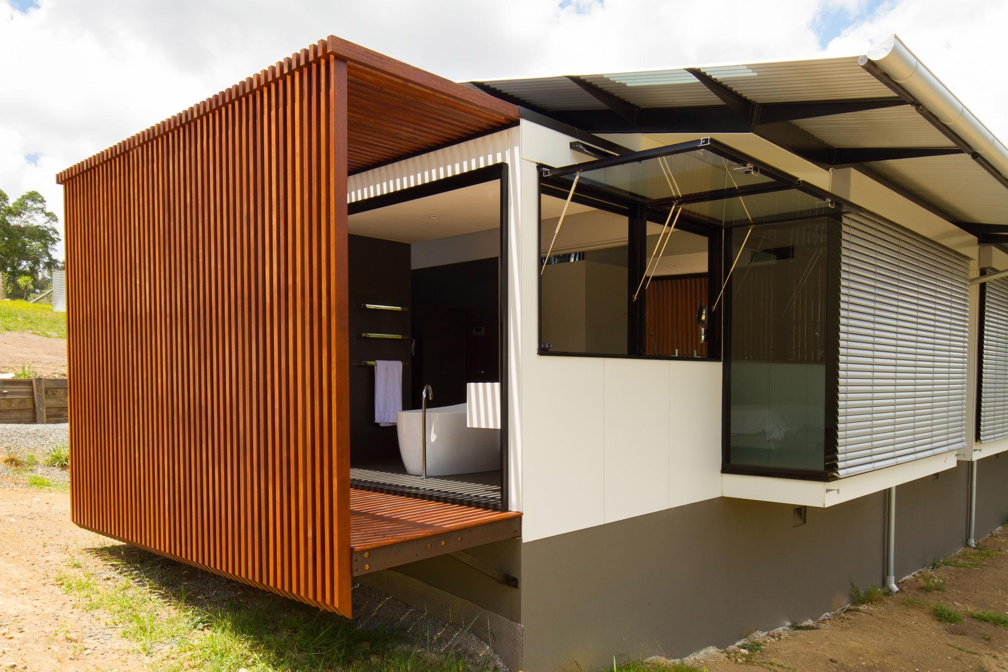 Dise o de casa moderna en terreno largo y angosto for Ver construcciones de casas