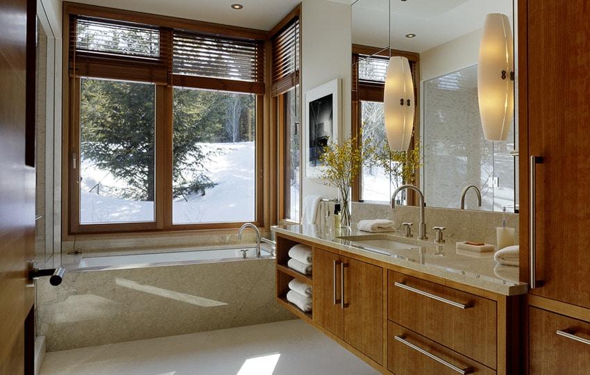 Dise o de moderna casa de campo en madera y piedra for Diseno de habitacion con bano y cocina