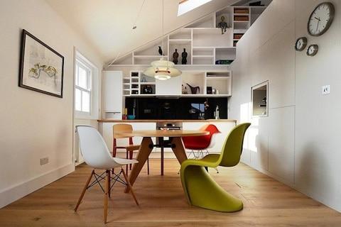 Diseño de mini apartamento comedor y kitchenet