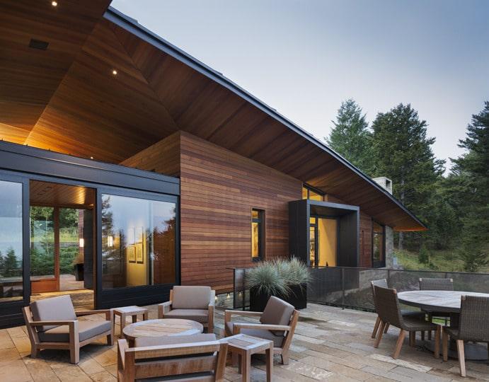 Dise o de moderna casa de campo en madera y piedra for Fachadas de terrazas rusticas