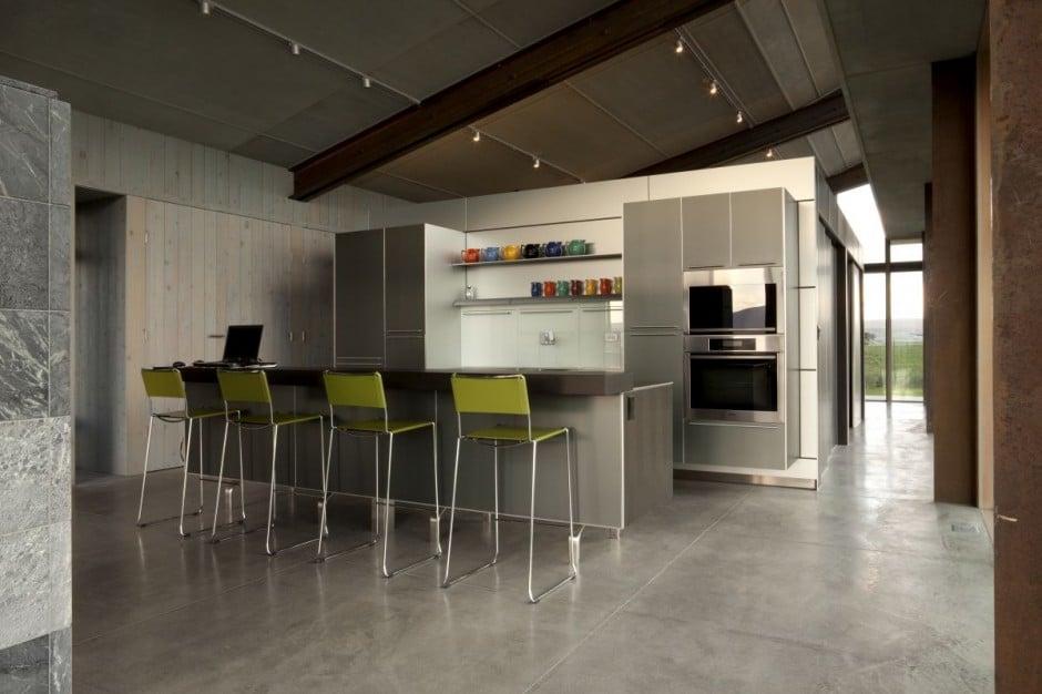Dise o de moderna casa peque a con grandes ventanas for Cocinas pequenas con desayunador fotos