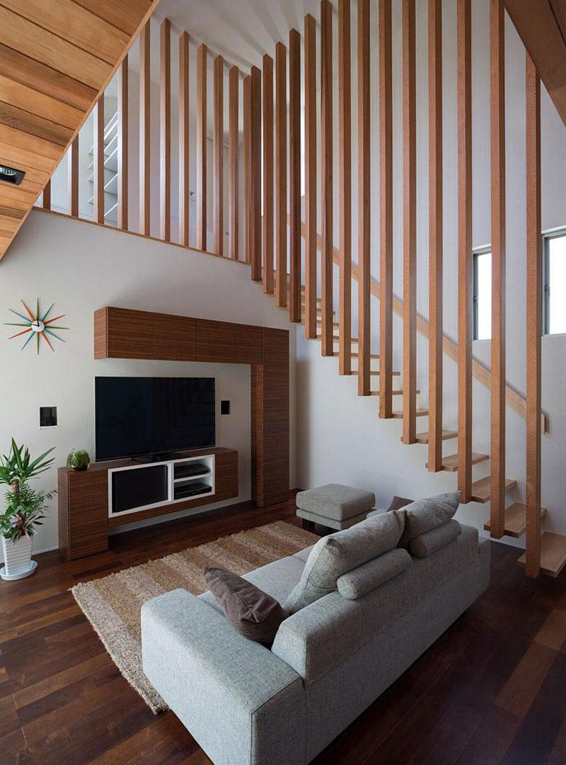 Dise o de moderna casa de dos plantas con planos de vivienda for Salas con escaleras